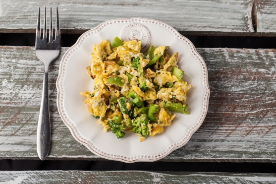 Scrambled Eggs and Vegetables on weathered wood